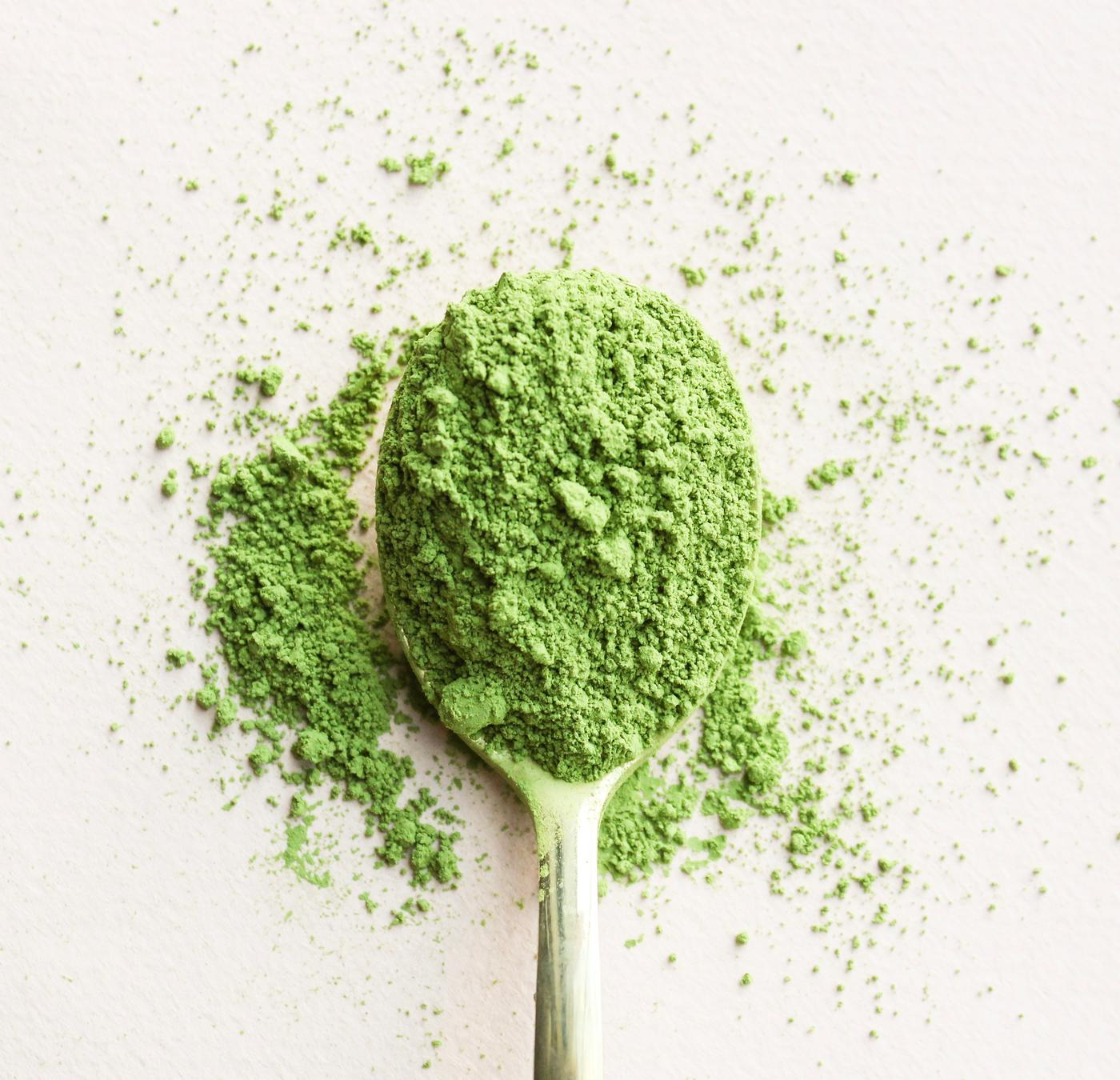 Powdered green tea and wooden spoon